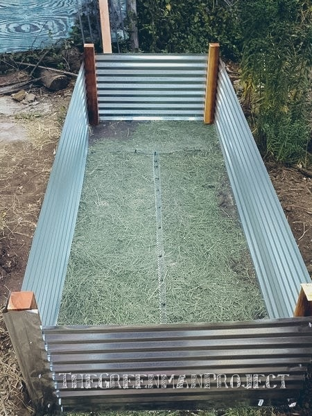 main frame completed with hardware cloth added to keep the unwantables from entering from below - Raised Bed Frame