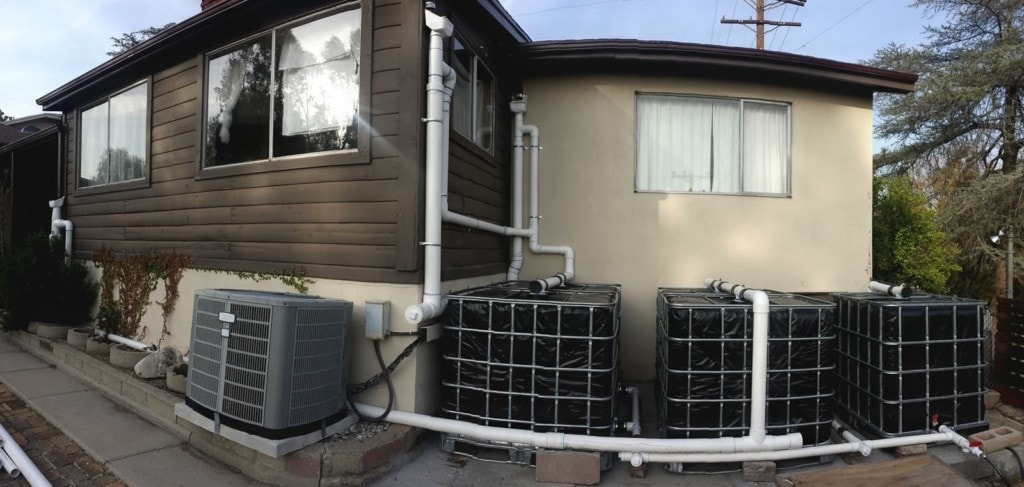 Rainwater Harvesting - 5 IBC totes with 4 RainHeads 2 wet systems and a wet overflow - The Greenman Project