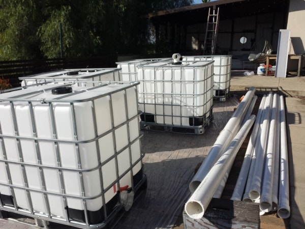 Rainwater Harvesting - IBC totes and large PVC pipes - The Greenman Project